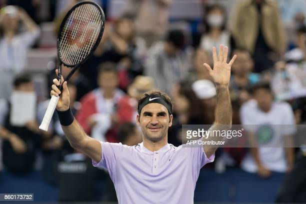 Roger Federer of Switzerland celebrates wining his match at the end of his men's 2nd round singles match against Diego Schwartzman of Argentina at...