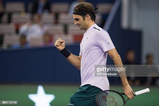 Roger Federer of Switzerland celebrates wining his match during his men's 2nd round singles match against Diego Schwartzman of Argentina at the...