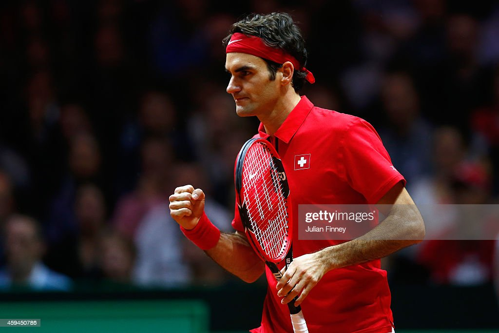 Roger Federer of Switzerland celebrates winning a game against Richard Gasquet of France during day three of the Davis Cup Tennis Final between...