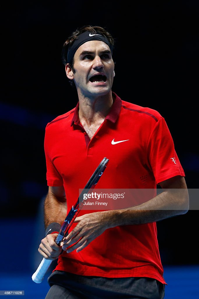 Roger Federer of Switzerland celebrates winning a game in his match against Milos Raonic of Canada in the round robin during day one of the Barclays ATP World Tour Finals tennis at O2 Arena on November 9, 2014 in London, England.
