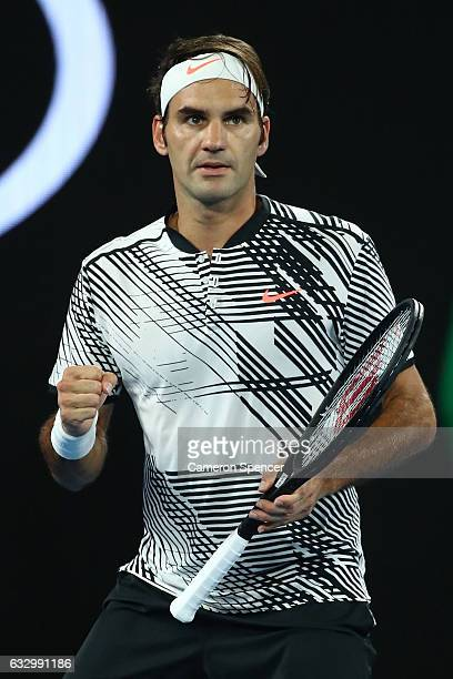 Roger Federer of Switzerland celebrates winning a game in his Men's Final match against Rafael Nadal of Spain on day 14 of the 2017 Australian Open...