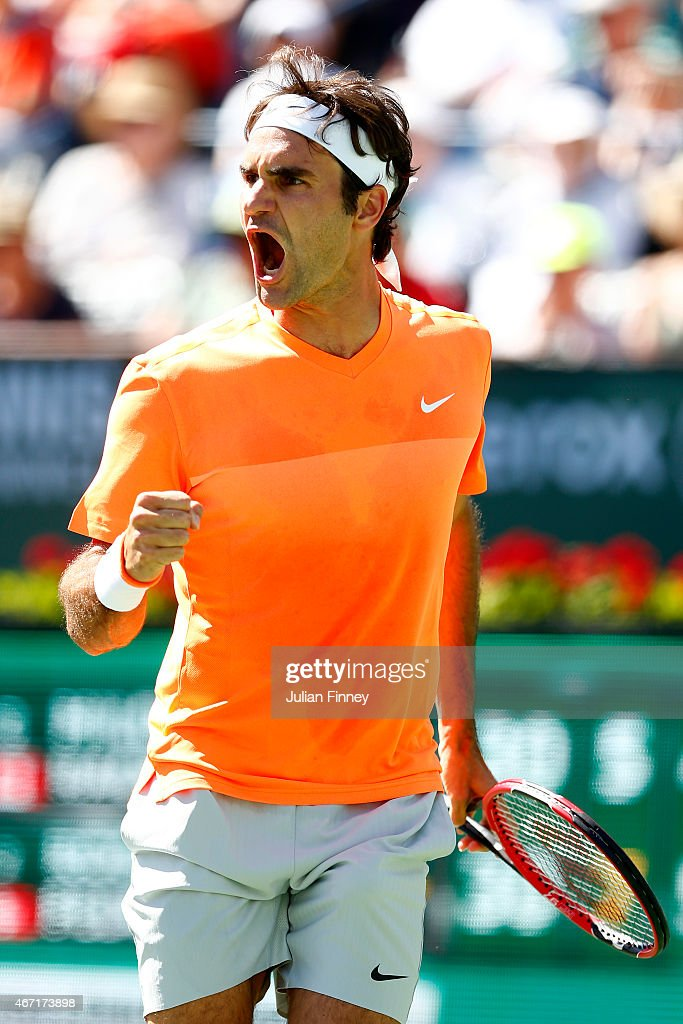 Roger Federer of Switzerland celebrates winning a point against Milos Raonic of Canada during day thirteen of the BNP Paribas Open tennis at the...