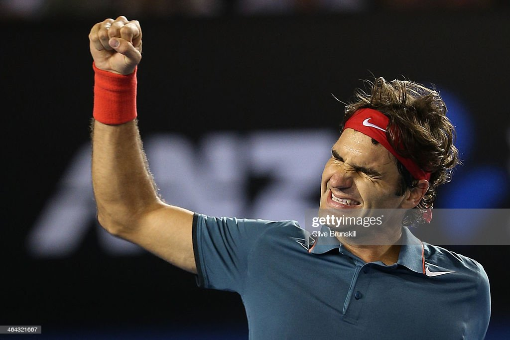<a gi-track='captionPersonalityLinkClicked' href=/galleries/search?phrase=Roger+Federer&family=editorial&specificpeople=157480 ng-click='$event.stopPropagation()'>Roger Federer</a> of Switzerland celebrates winning his quarterfinal match against Andy Murray of Great Britain during day 10 of the 2014 Australian Open at Melbourne Park on January 22, 2014 in Melbourne, Australia.