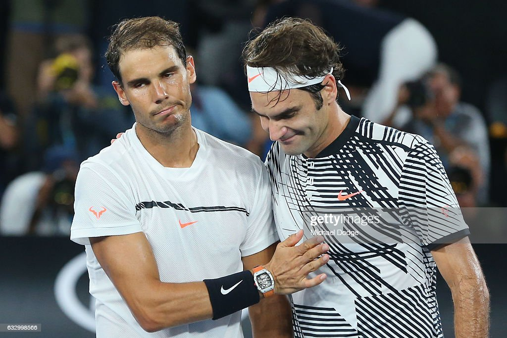 Roger Federer of Switzerland (R) celebrates winning in the Men's Final match against Raphael Nadal of Spain on day 14 of the 2017 Australian Open at Melbourne Park on January 29, 2017 in Melbourne, Australia.