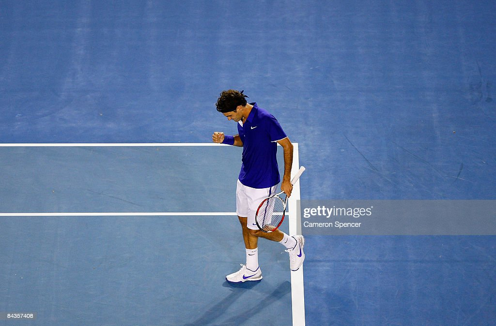 Roger Federer of Switzerland celebrates winning match point after his first round match against Andreas Seppi of Italy during day one of the 2009 Australian Open at Melbourne Park on January 19, 2009 in Melbourne, Australia.