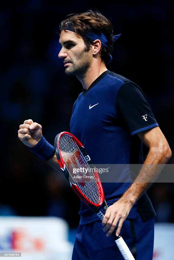 Roger Federer of Switzerland celebrates winning the first set in his men's singles match against Novak Djokovic of Serbia during day three of the Barclays ATP World Tour Finals at the O2 Arena on November 17, 2015 in London, England.