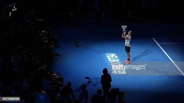 Roger Federer of Switzerland celebrates winning the Men's Final match against Rafael Nadal of Spain on day 14 of the 2017 Australian Open at...
