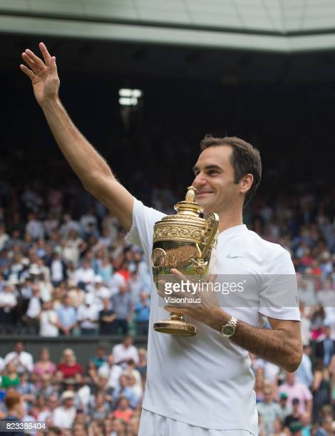 Roger Federer of Switzerland celebrates winning the Men's Singles Final against Marin Cilic on day thirteen of the Wimbledon Lawn Tennis...