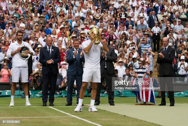 Roger Federer of Switzerland celebrates with the Trophy after his victory against Marin Cilic of Croatia in their Gentlemen's Singles Final at...