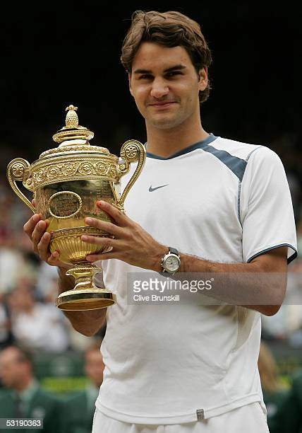 Roger Federer of Switzerland celebrates with the trophy after winning in straight sets against Andy Roddick of the USA in the Mens Singles final...