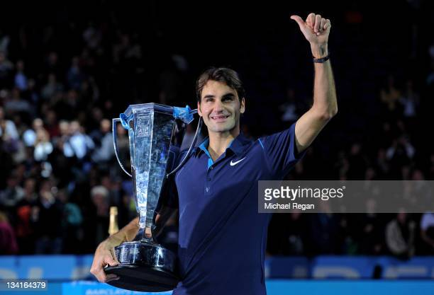 Roger Federer of Switzerland celebrates with the trophy following his victory during the men's final singles match against JoWilfried Tsonga of...