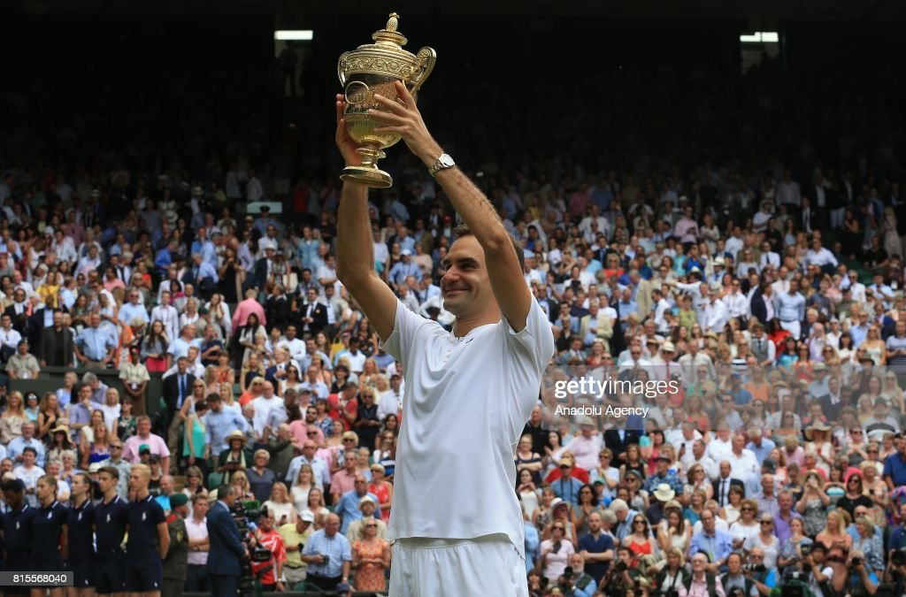 Roger Federer of Switzerland celebrates with the winner's trophy after beating Marin Cilic (not seen) of Croatia in the men's final of the 2017 Wimbledon Championships at the All England Lawn and Croquet Club in London, United Kingdom on July 16 2017.