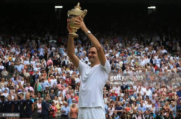 Roger Federer of Switzerland celebrates with the winner's trophy after beating Marin Cilic of Croatia in the men's final of the 2017 Wimbledon...