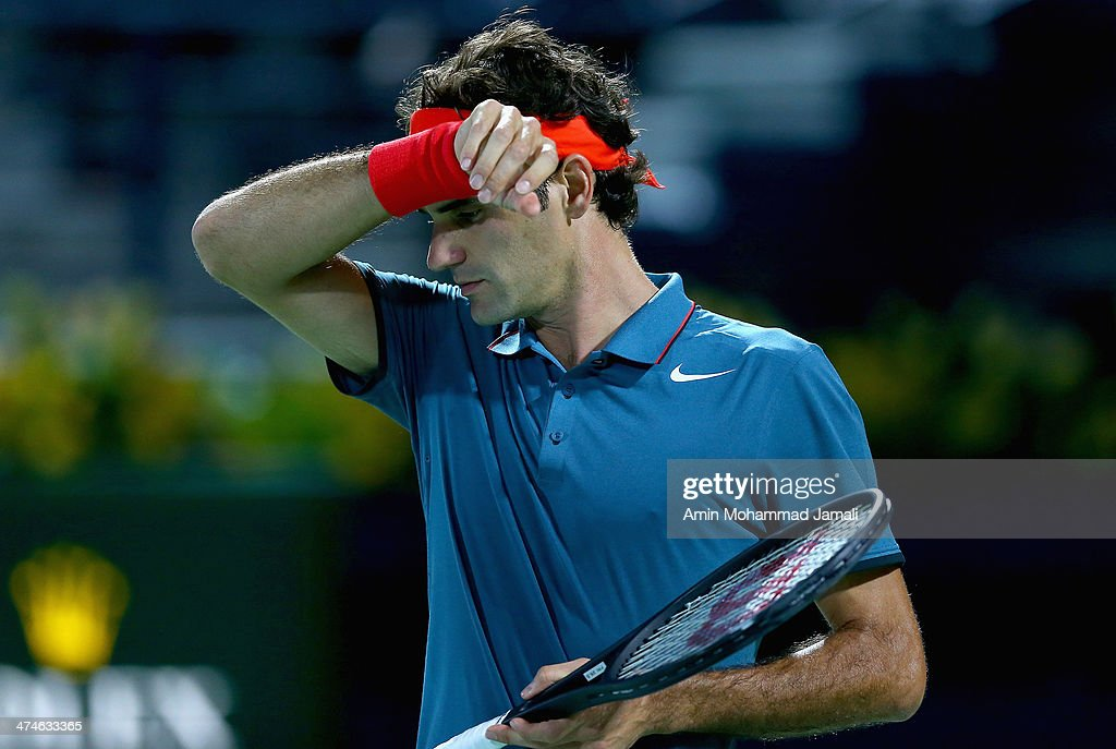 <a gi-track='captionPersonalityLinkClicked' href=/galleries/search?phrase=Roger+Federer&family=editorial&specificpeople=157480 ng-click='$event.stopPropagation()'>Roger Federer</a> of Switzerland during their first round match with Benjamin Becker of Germany on Dubai Duty Free Tennis ATP Championships in Dubai,on February 24, 2014 in Dubai, United Arab Emirates.