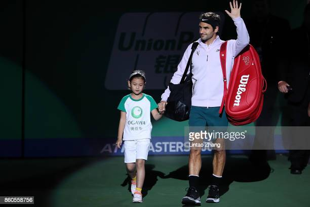 Roger Federer of Switzerland enters the tennis court during the Men's singles mach second round against Alexandr Dolgopolov of Ukraine on day five of...
