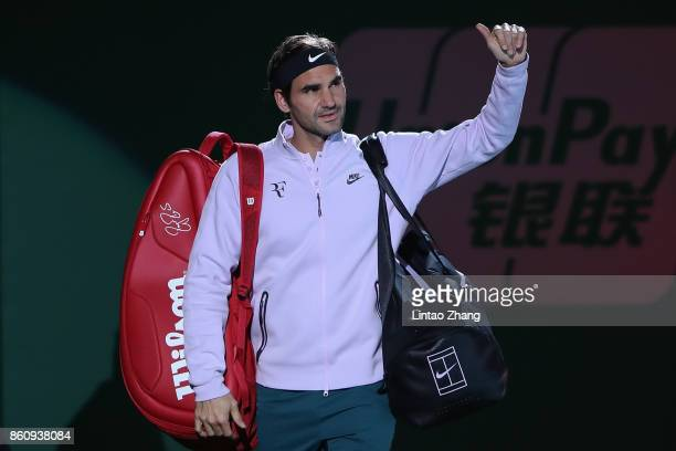 Roger Federer of Switzerland enters the tennis court during the Men's singles quarter final mach against Richard Gasquet of France on day six of 2017...