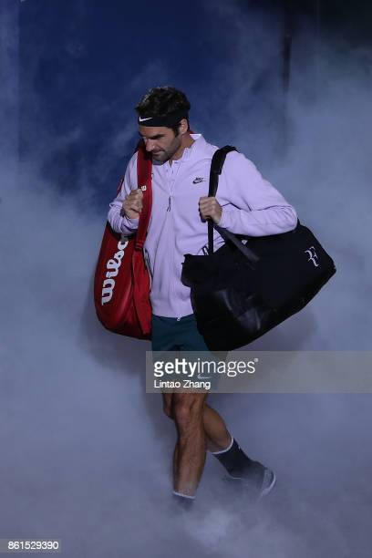 Roger Federer of Switzerland enters the tennis court during the Men's singles final mach against Rafael Nadal of Spain on day eight of 2017 ATP...