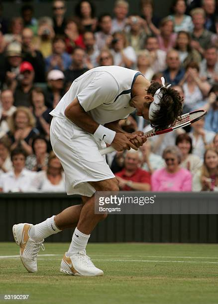Roger Federer of Switzerland falls to the ground at match point after defeating Andy Roddick of the USA in the Mens Singles final during the...