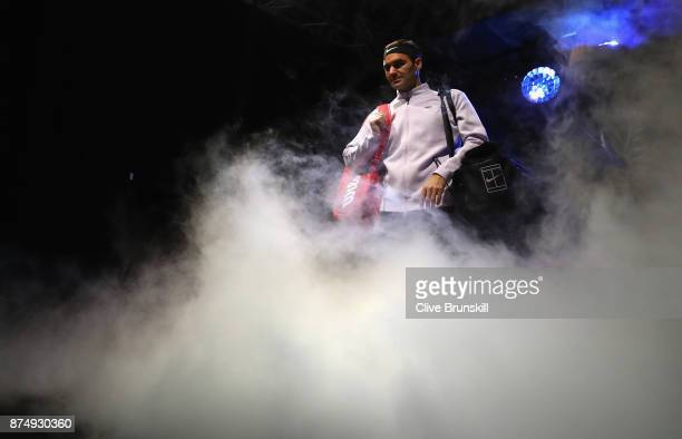 Roger Federer of Switzerland gets ready to walk out on court for his third round robin match against Marin Cilic of Croatia during the Nitto ATP...