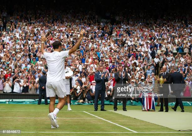 Roger Federer of Switzerland goes up to receive the Trophy from HRH Prince Michael of Kent after his victory over Marin Cilic of Croatia in their...