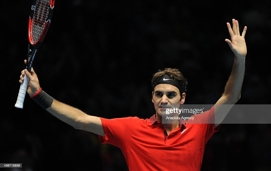 Roger Federer of Switzerland greets his supporters during the match against Milos Raonic of Canada on day one of the Barclays ATP World Tour Finals tennis at O2 Arena on November 9, 2014 in London, England.