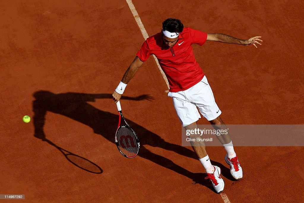 Roger Federer of Switzerland hits a backhand during the men's singles quarterfinal match between Gael Monfils of France and Roger Federer of...