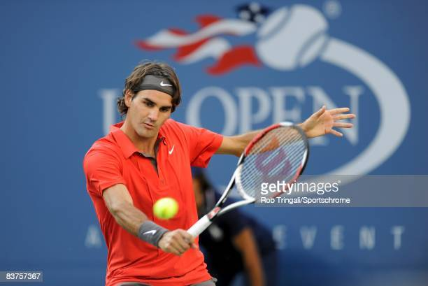 Roger Federer of Switzerland hits a backhanded shot back to Andy Murray of the United Kingdom in the 2008 US Open Men's Championship Match in Arthur...
