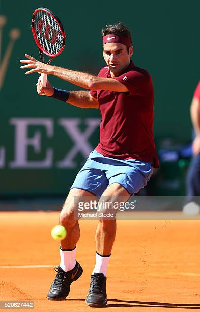 Roger Federer of Switzerland hits a forehand during the second round match against Guillermo GarciaLopez of Spain on day three of the Monte Carlo...