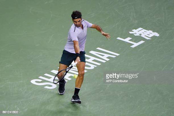 Roger Federer of Switzerland hits a return against Juan Martin del Potro of Argentina during their men's singles semifinal match at the Shanghai...