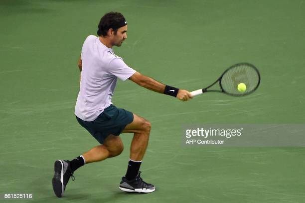 Roger Federer of Switzerland hits a return against Rafael Nadal of Spain during their men's singles final match at the Shanghai Masters tennis...