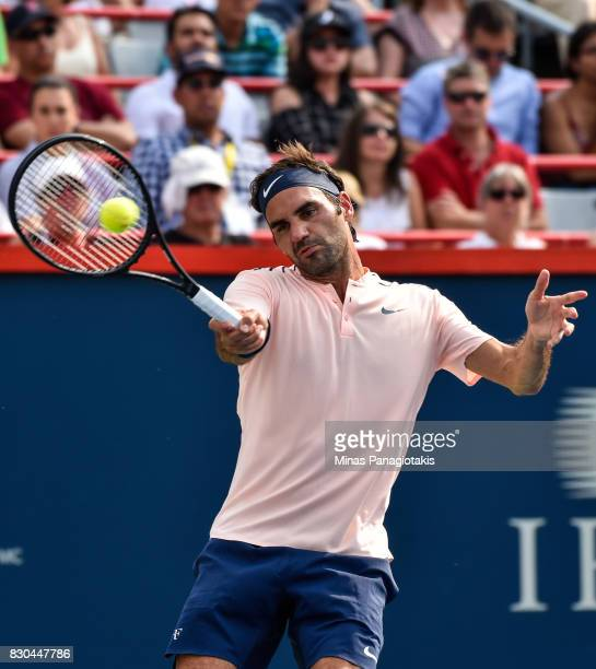 Roger Federer of Switzerland hits a return against Roberto Bautista Agut of Spain during day eight of the Rogers Cup presented by National Bank at...