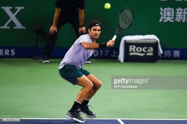 Roger Federer of Switzerland hits a return during the men's singles against Alexandr Dolgopolov of Ukraine at the Shanghai Masters tennis tournament...