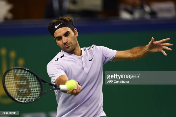 Roger Federer of Switzerland hits a return during the men's quarterfinals singles match against Richard Gasquet of France at the Shanghai Masters...