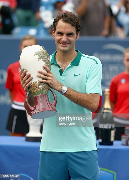 Roger Federer of Switzerland hods the winner's trophy after beating of David Ferrer of Spain 631662 during the finals of the Western Southern Open on...