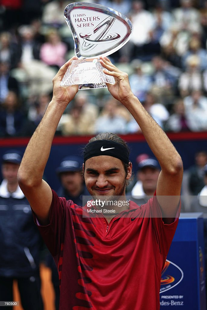Roger Federer of Switzerland holds aloft the Masters Series trophy after winning the ATP Tennis Masters Series held in Hamburg, Germany on May 19, 2002. DIGITAL