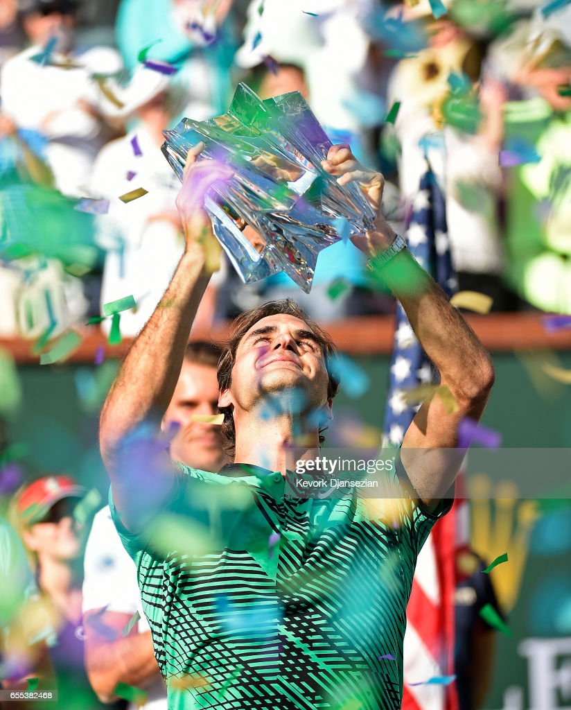 Roger Federer of Switzerland holds the BNP Paribas Open trophy after his straight sets victory against Stanislas Wawrinka of Switzerland in the mens final during day fourteen of the BNP Paribas Open at Indian Wells Tennis Garden on March 19, 2017 in Indian Wells, California.