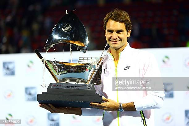 Roger Federer of Switzerland holds the trophy after winning the final match against Novak Djokovic of Serbia during men's singles Final match of the...