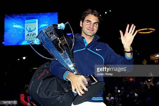 Roger Federer of Switzerland holds the trophy following his victory during the men's final singles match against JoWilfried Tsonga of France during...