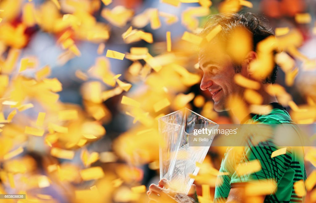 Roger Federer of Switzerland holds the winner's trophy after defeating Rafael Nadal of Spain during the Men's Final and day 14 of the Miami Open at Crandon Park Tennis Center on April 2, 2017 in Key Biscayne, Florida.