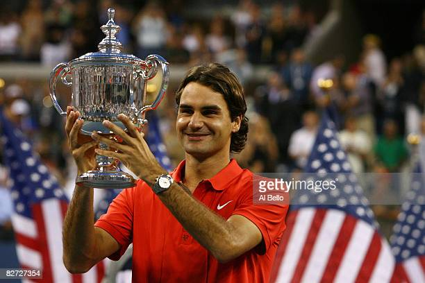 Roger Federer of Switzerland holds up the trophy after defeating Andy Murray of the United Kingdom to win the 2008 US Open Men's Championship Match...