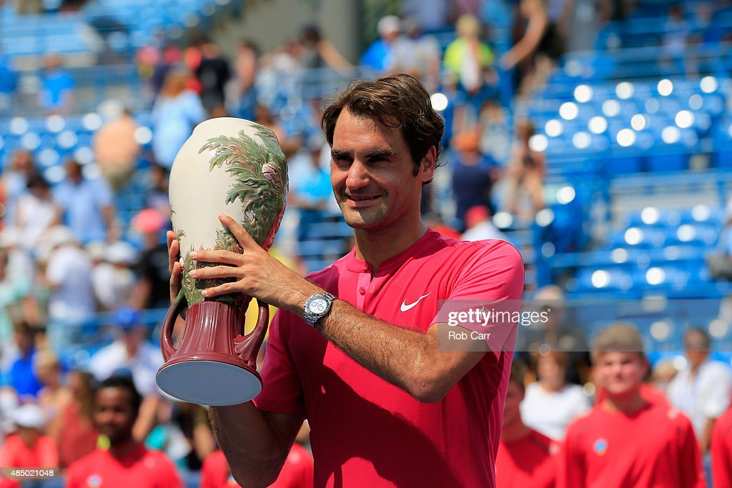 Roger Federer of Switzerland holds up the trophy after defeating Novak Djokovic of Serbia to win the mens singles final at the Western Southern Open...