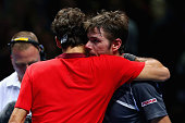 Roger Federer of Switzerland hugs Stan Wawrinka of Switzerland afte the singles semifinal match on day seven of the Barclays ATP World Tour Finals at...