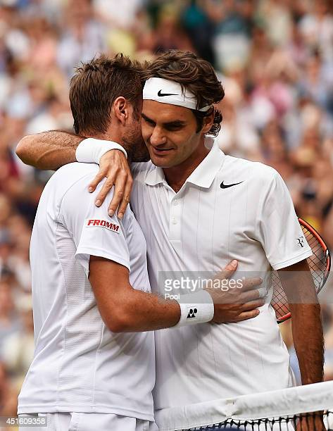 Roger Federer of Switzerland hugs Stan Wawrinka of Switzerland after their Gentlemen's Singles quarterfinal match on day nine of the Wimbledon Lawn...