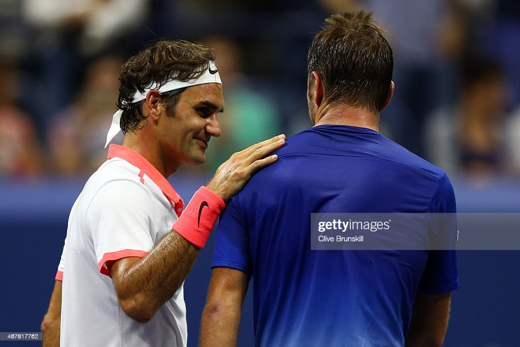 Roger Federer of Switzerland hugs Stan Wawrinka of Switzerland after their Men's Singles Semifinals match on Day Twelve of the 2015 US Open at the USTA Billie Jean King National Tennis Center on September 11, 2015 in the Flushing neighborhood of the Queens borough of New York City.