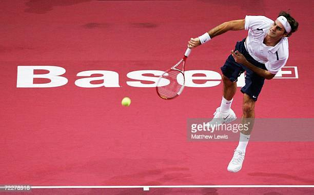 Roger Federer of Switzerland in action against David Ferrer of Spain during the ATP Davidoff Swiss Indoors Tournament at StJakobshalle on October 27...