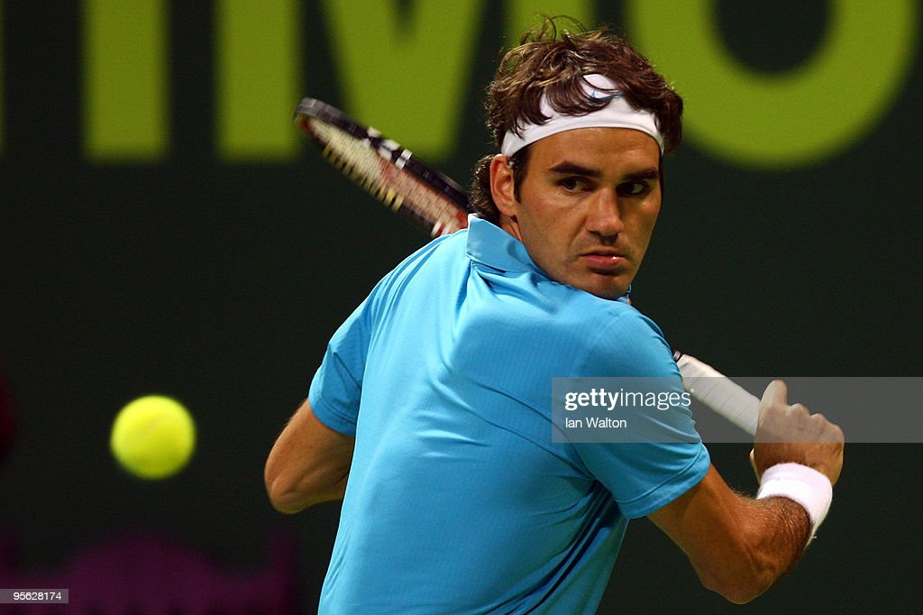 Roger Federer of Switzerland in action against Ernests Gulbis of Latvia during the quarter final match of the ATP Qatar ExxonMobil Open at the...