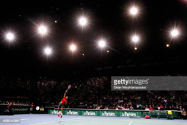 Roger Federer of Switzerland in action against Jeremy Chardy of France during day 3 of the BNP Paribas Masters held at the at Palais Omnisports de...