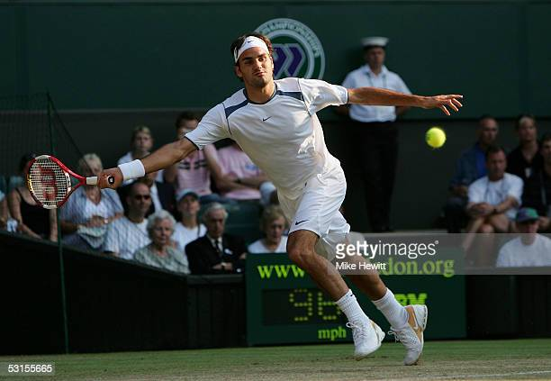Roger Federer of Switzerland in action against Juan Carlos Ferrero of Spain during the seventh day of the Wimbledon Lawn Tennis Championship on June...