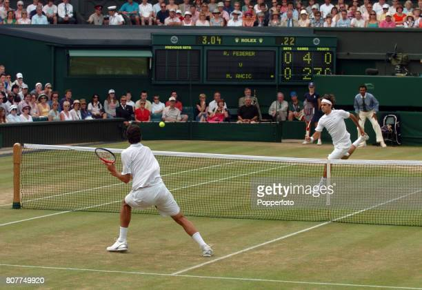 Roger Federer of Switzerland in action against Mario Ancic of Croatia during day nine of the Wimbledon Lawn Tennis Championships at the All England...