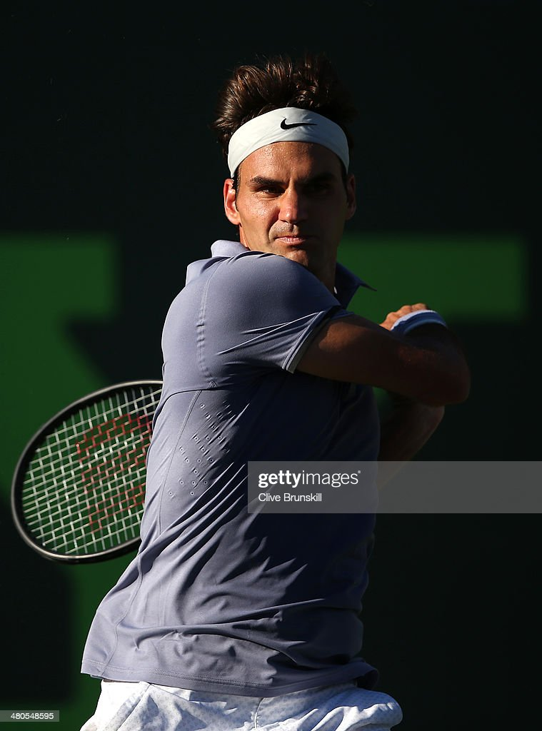 Roger Federer of Switzerland in action against Richard Gasquet of France during their fourth round match during day 9 at the Sony Open at Crandon Park Tennis Center on March 25, 2014 in Key Biscayne, Florida.